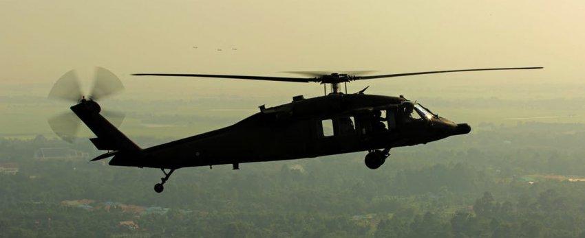 Черные вертолеты, меняющие свою форму